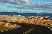 pic of veer  - A black Desert highway road veering left into the distance - JPG