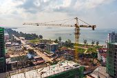 Construction Of Multi-storey Buildings In Cambodia, Sihanoukville . Construction Cranes On Backgroun poster