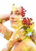 Double exposure portrait of bright green leaves and red fruits combined with a peaceful womans face poster