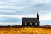 Gorgeous autumn landscape with famous picturesque black church of Budir at Snaefellsnes peninsula re poster