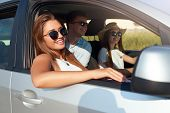 Group Of Friends Rented A Car On Summer Road Trip And Arrived To The Sea Beach. Woman In Glasses Loo poster