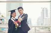 Graduate Students And Success Education In University Concept. Happy Couple Of Asian Students Gradua poster