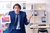 Young male employee unhappy with excessive work  poster