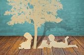 stock photo of paper cut out  - Paper cut of children read a book under tree - JPG