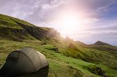 camping in the wilderness of the scottish isle of skye near the quirang mountain range poster