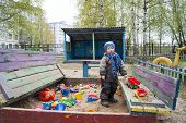 A Little Boy Of Three Years Old On A Cool Spring Sunny Day Playing In The Sandbox Of A Kindergarten, poster