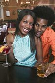 pic of soliciting  - Portrait of couple drinking at bar - JPG