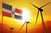 Dominican Republic Wind Energy, Alternative Energy Environment Concept With Turbines And Flag On Sun poster