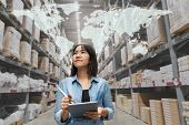 Young Attractive Asian Manager Woman Looking, Picking, Replemishment, Receiving Inventory At Store W poster