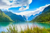 Norwegian Landscape With Nordfjord Fjord, Mountains, Flowers And Glacier In Olden, Norway poster