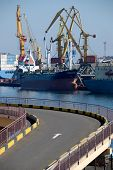 stock photo of shadoof  - Cargo loading in port with cranes  - JPG
