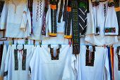 stock photo of suceava  - Romanian Traditional Clothes at a souvenir shop near Voronet Monastery Suceava Romania - JPG