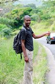 African Traveler Hitchhiking On The Road poster