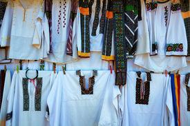 picture of suceava  - Romanian Traditional Clothes at a souvenir shop near Voronet Monastery Suceava Romania - JPG