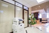 pic of reception-area  - Light corridor near reception in business company with sofas and chairs - JPG