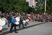 KUALA LUMPUR - AUGUST 31: Drums and brass band from the Malaysian Police Force march on the city str