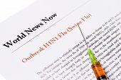 pic of swine flu  - Newspaper headline about outbreak swine flu with syringe filled with antivirus - JPG