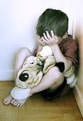 foto of child abuse  - Lonely boy being punished in the corner - JPG