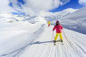 Skiing, winter, ski lesson - skiers on ski run