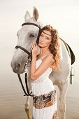 stock photo of horse-riders  - Beautiful woman on a horse - JPG
