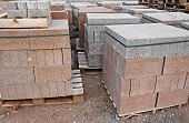 stock photo of cinder block  - skids of breeze blocks at a builders supplies yard also known as cinder blocks in the us or Concrete masonry units - JPG