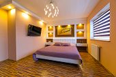 pic of master bedroom  - Modern master bedroom interior with picture of shipwreck on the wall  - JPG