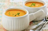 stock photo of ribs  - Creamy carrot and sweet potato soup with sprig of thyme in white ribbed soup bowls - JPG