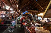 PADANG - AUGUST 25: Traders work at their stalls sell local farm produce at a village market in Pada