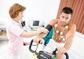 stock photo of ekg  - Nurse makes the patient ready for medical EKG test - JPG