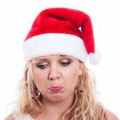 image of sad christmas  - Sad woman in Christmas hat isolated on white background - JPG