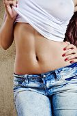 foto of belly-button  - Closeup photo of beautiful and sexy body of young girl - JPG