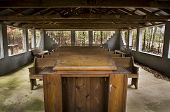 foto of pews  - a rural outdoor church with wooden pews and pulpit - JPG