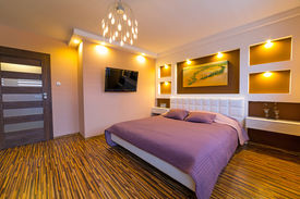 picture of master bedroom  - Modern master bedroom interior with picture of shipwreck on the wall  - JPG