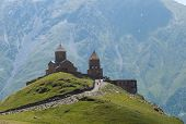image of trinity  - The Gergeti Trinity Church is the main cultural landmark of Kazbegi District (Stepantsminda) Georgia. The church is situated at an elevation of 2170 meters under Mount Kazbek.