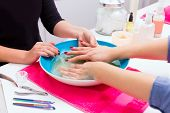 Nail saloon scrub bath exfoliant hands skin renewal in bowl water