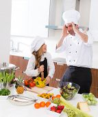 Постер, плакат: Chef master and junior kid girl at cooking school crazy man about pupil recipe