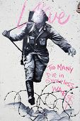 BERLIN GERMANY - 18 NOVEMBER 2013:Graffiti on a wall in Berlin depicting a Nazi soldier, with the sl