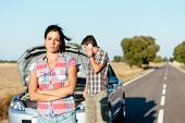 image of breakdown  - Upset woman waiting for car help while man arguing on the cellphone with insurance service - JPG