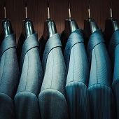 stock photo of apparel  - Row of men suit jackets in apparel store - JPG