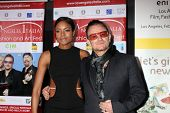 LOS ANGELES - FEB 23:  Naomie Harris, Bono at the LA Italia Opening Night at TCL Chinese 6 Theaters