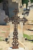 Tombstone With Cross Ornament At A French Cemetery