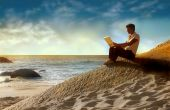 stock photo of informatics  - men using laptop in a enchanting sea scape at the sunset - JPG