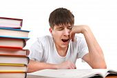 stock photo of yawn  - Tired Student Yawning on the School Desk Isolated on the White - JPG