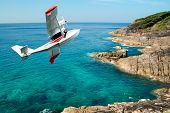 image of hydroplanes  - hydroplane flying over beauty rock - JPG