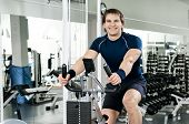 stock photo of execution  - young joy athletic guy execute exercise on exercise - JPG