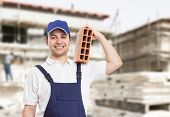 stock photo of bricklayer  - Portrait of a bricklayer at work - JPG
