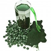 stock photo of algae  - Spirulina algae powder glass drink nutritional supplement close up  - JPG