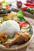 stock photo of ayam  - Popular delicious Indonesian local food nasi ayam penyet - JPG