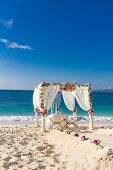 stock photo of wedding arch  - beach wedding set up - JPG