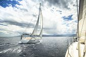 picture of sailing-ship  - Sailing yacht on the race in a stormy sea - JPG